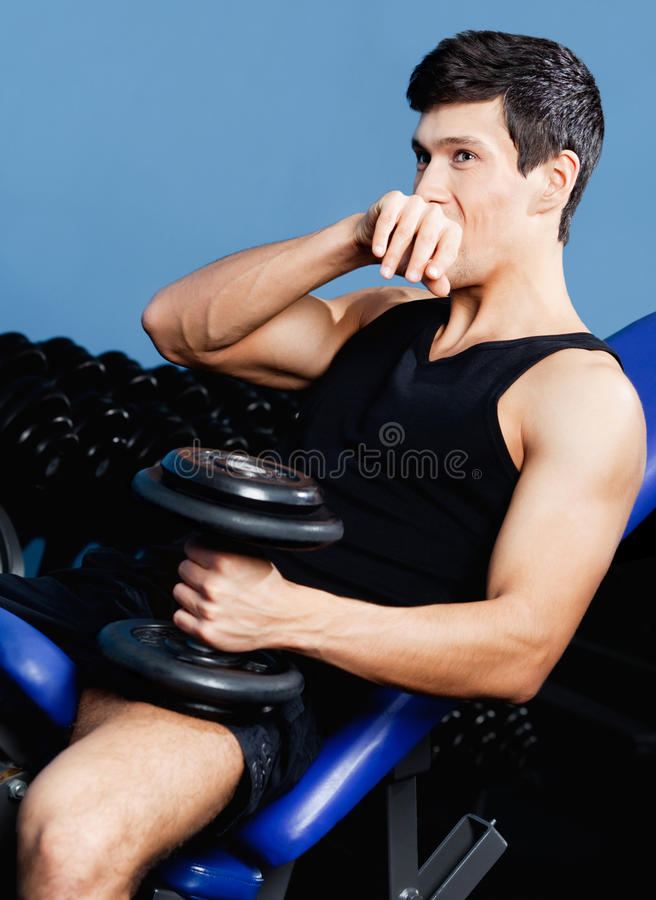 Download Sporty Man Rests Holding A Weight In The Hand Stock Image - Image: 26548293