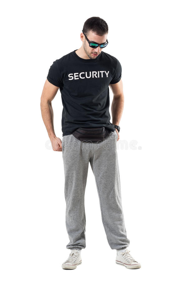 Sporty man with sunglasses and fanny pack waist back looking down stock image