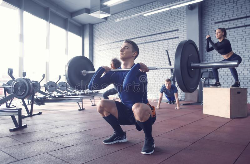 Sporty man training in weight room. Sporty men training in weight room royalty free stock photo