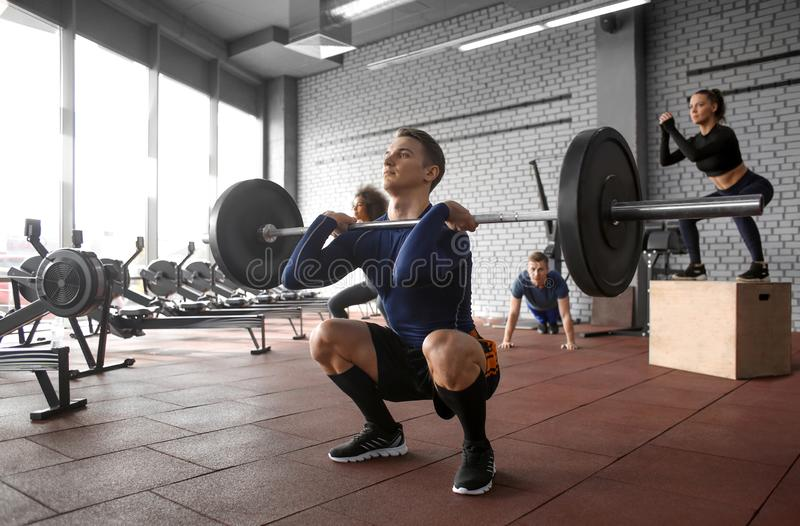 Sporty man training in weight room. Sporty men training in weight room stock photography
