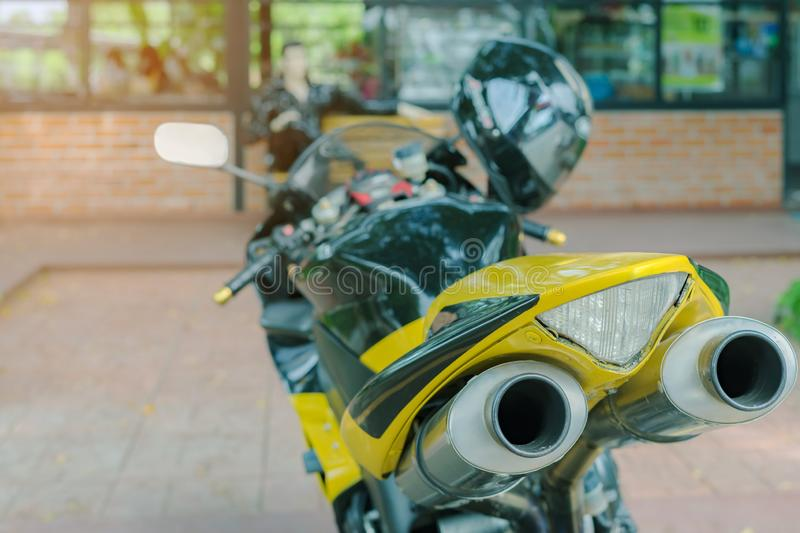 A sporty motorcycle parked. In front of a coffee shop royalty free stock image
