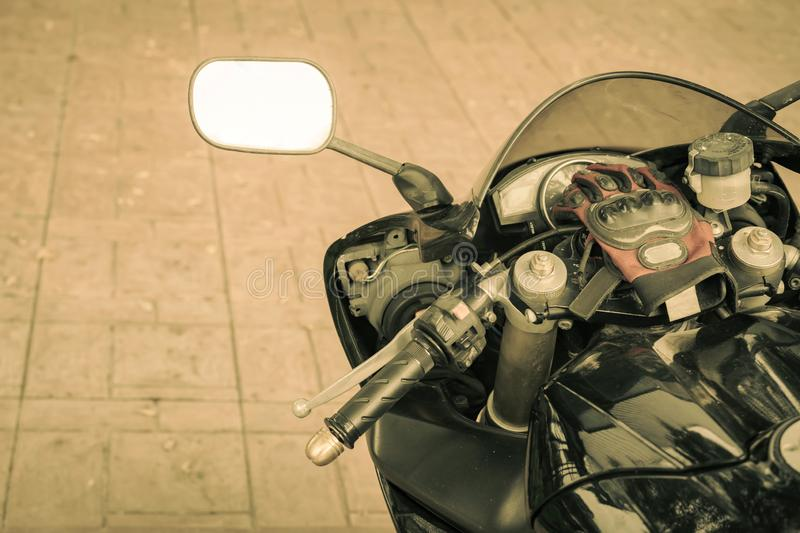 A sporty motorcycle parked. In front of a coffee shop stock image