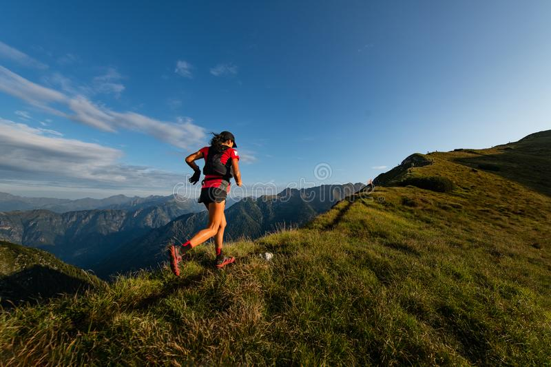 Sporty mountain woman rides in trail during endurance trail.  royalty free stock images