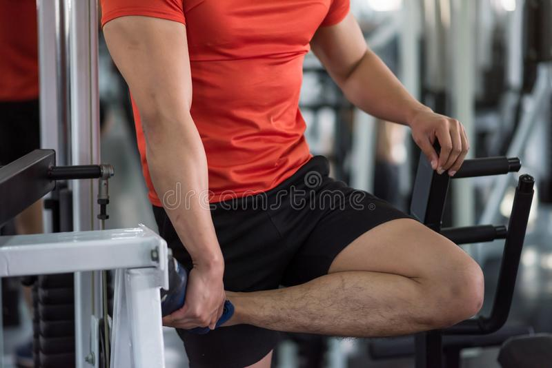 Sporty muscle man stretching exercises in fitness stock photos