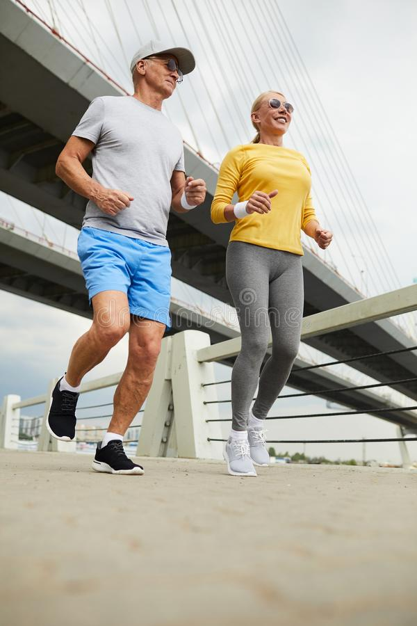 Seniors jogging stock photography