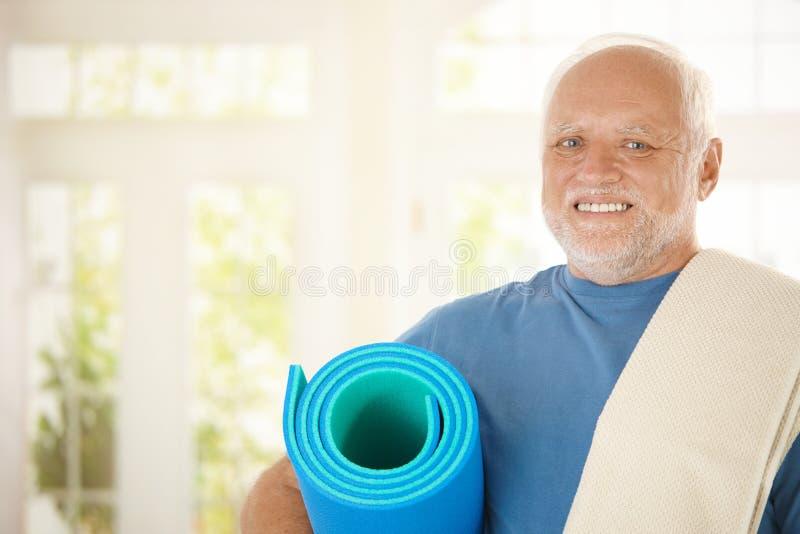 Sporty senior with polyfoam stock photo