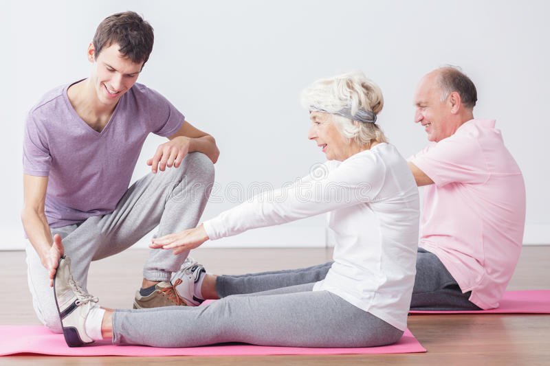Sporty seniors at fitness studio royalty free stock images