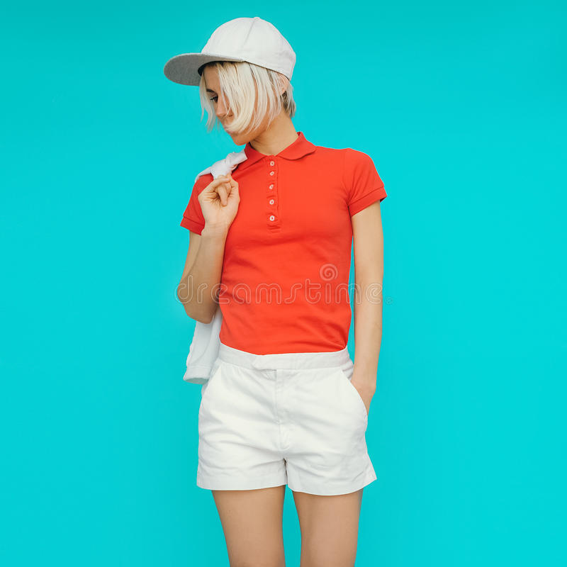 Sporty style. Girl in fashionable clothes and accessories.  royalty free stock photography