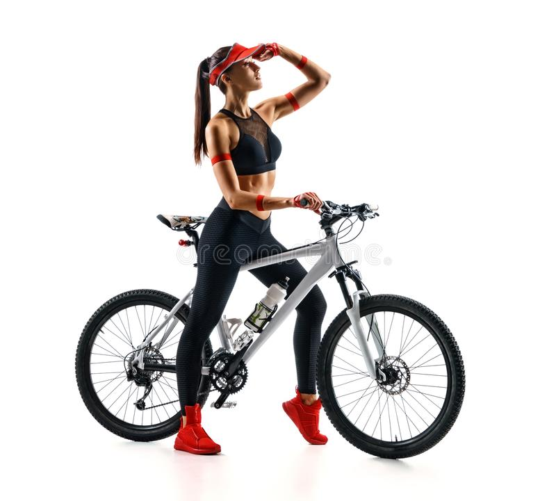 Sporty woman with bike looking into the distance in silhouette on white background. royalty free stock photos