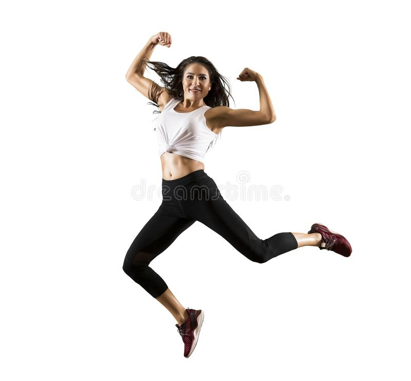 Sporty woman jumping on white background royalty free stock photos