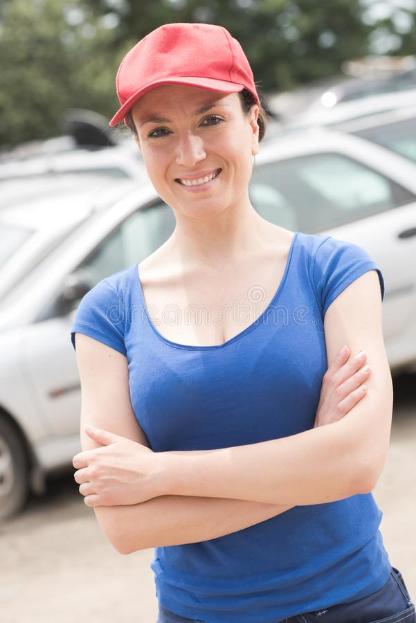 Sporty woman in car park stock photography