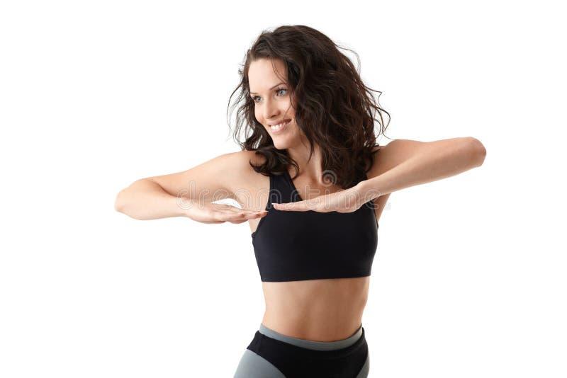Sporty woman doing exercise stock photo