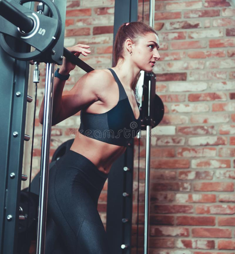 Sporty woman doing lunge exercise royalty free stock photography