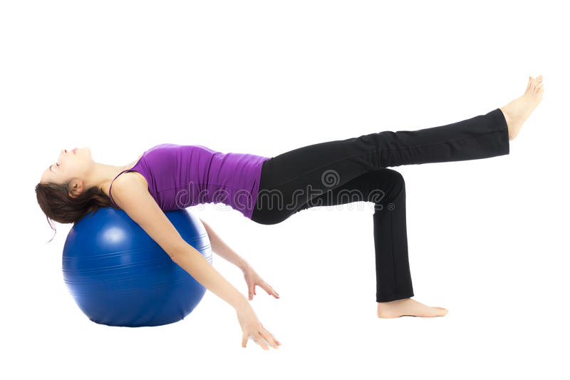 Sporty woman doing Pilates with a ball stock images