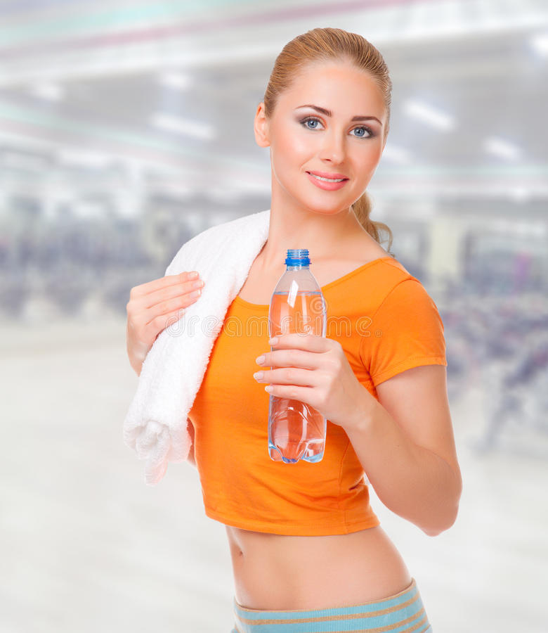 Sporty woman at fitness club royalty free stock photo