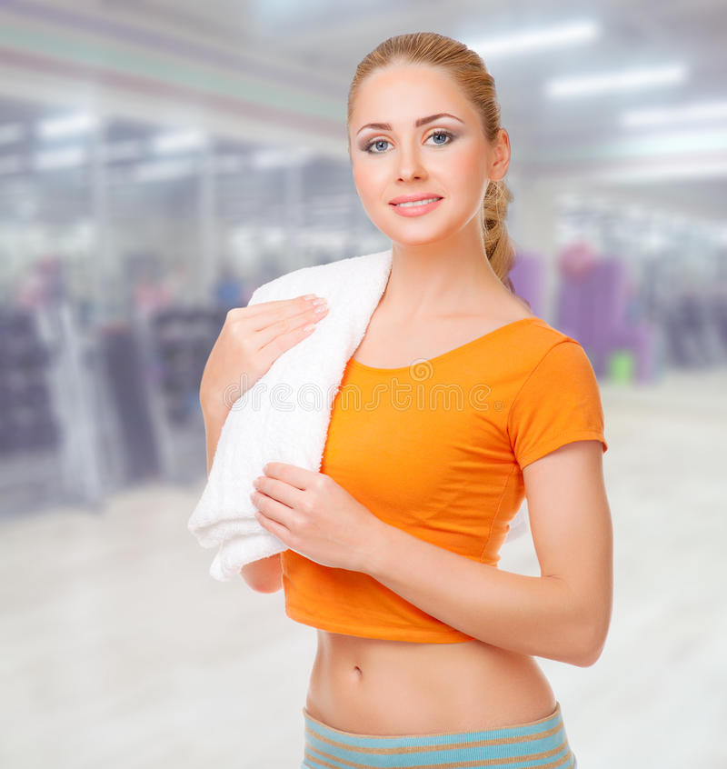 Sporty woman at fitness club stock photos