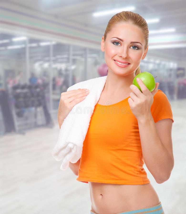 Sporty woman at fitness club royalty free stock images