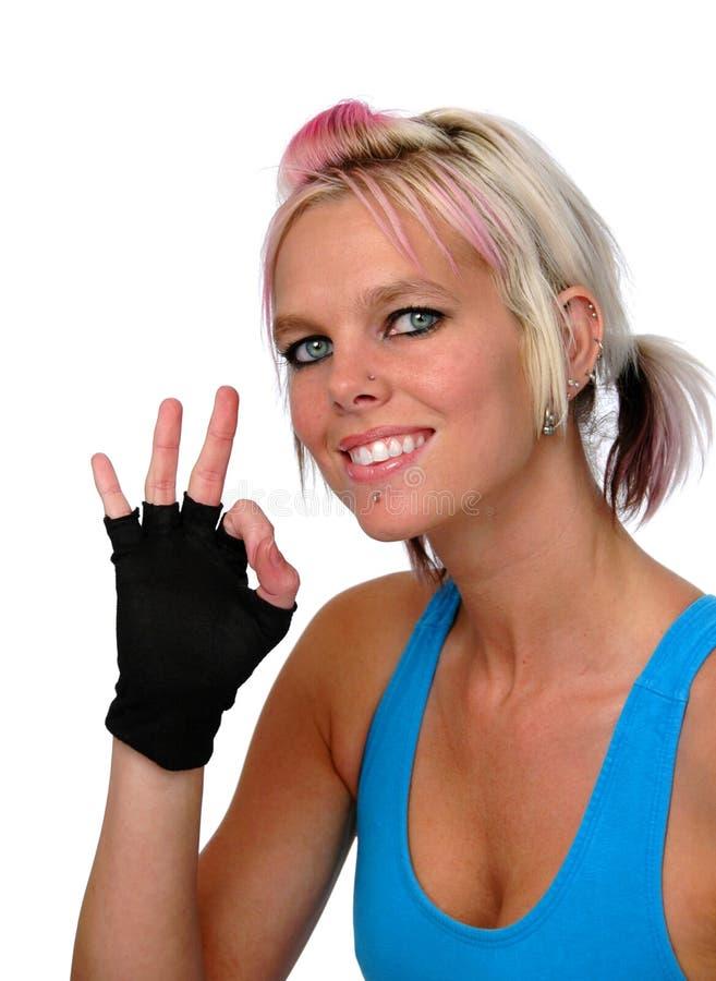 Sporty Woman Gesturing Okay Stock Photo