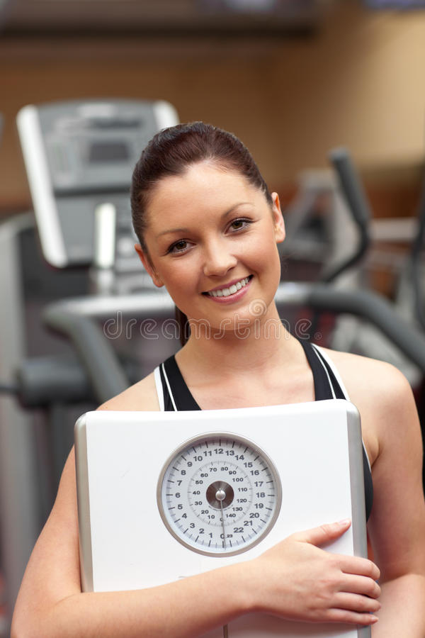 Download Sporty Woman Holding A Scale Stock Photo - Image: 15971220