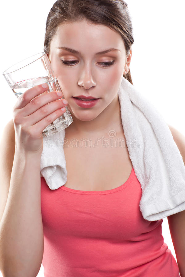 Sporty woman holding water royalty free stock images