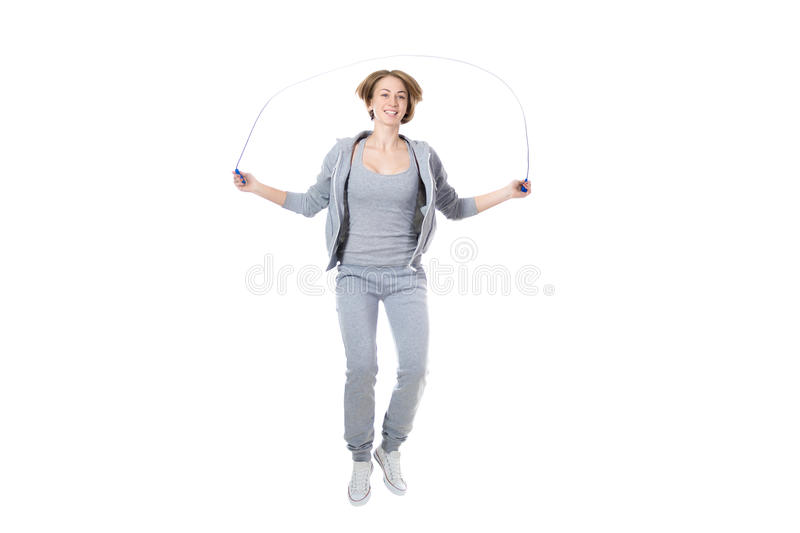 Sporty woman jumping rope royalty free stock image