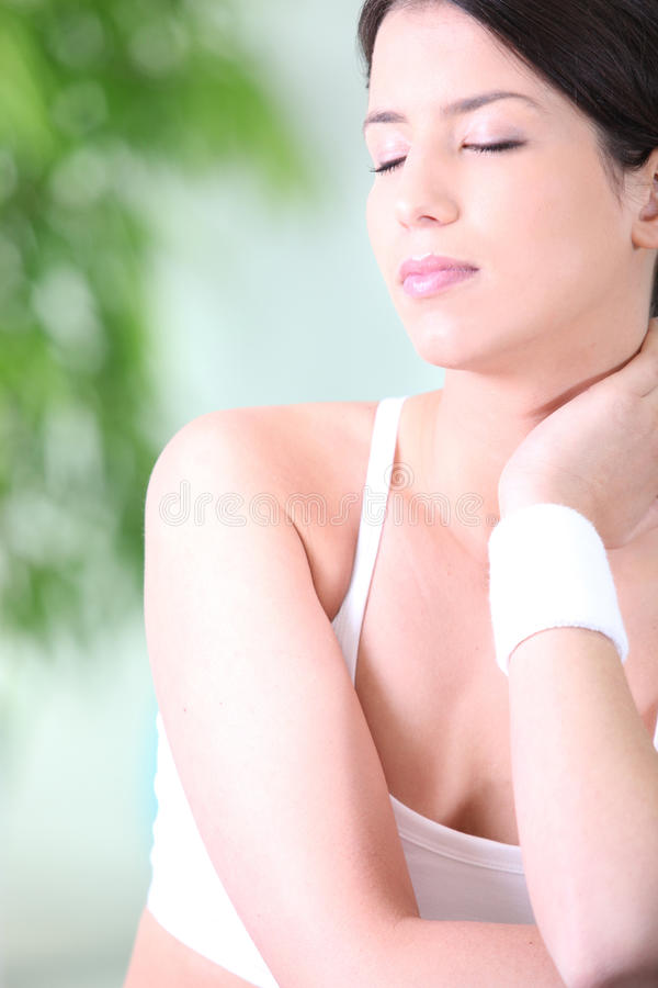 Download Sporty Woman With Neck Pain Stock Photo - Image: 24497744