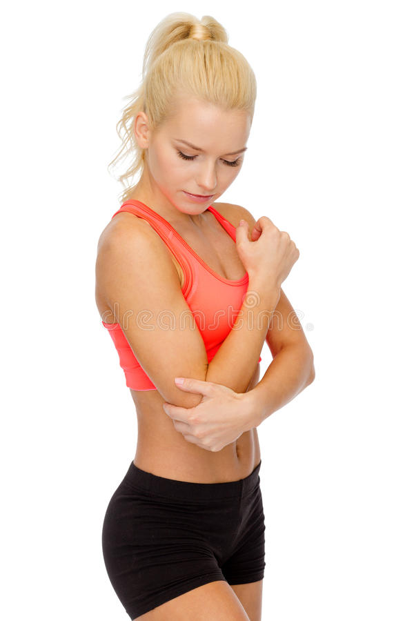 Sporty woman with pain in elbow. Healthcare, fitness and medicine - sporty woman with pain in elbow stock images