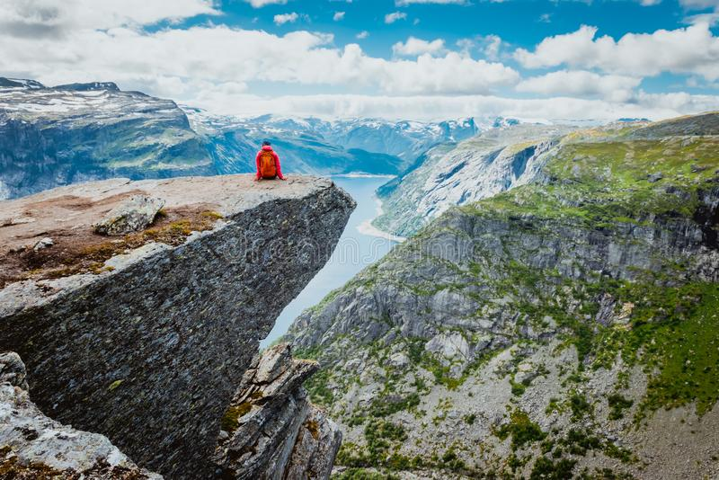 Sporty woman posing on Trolltunga Norway royalty free stock image
