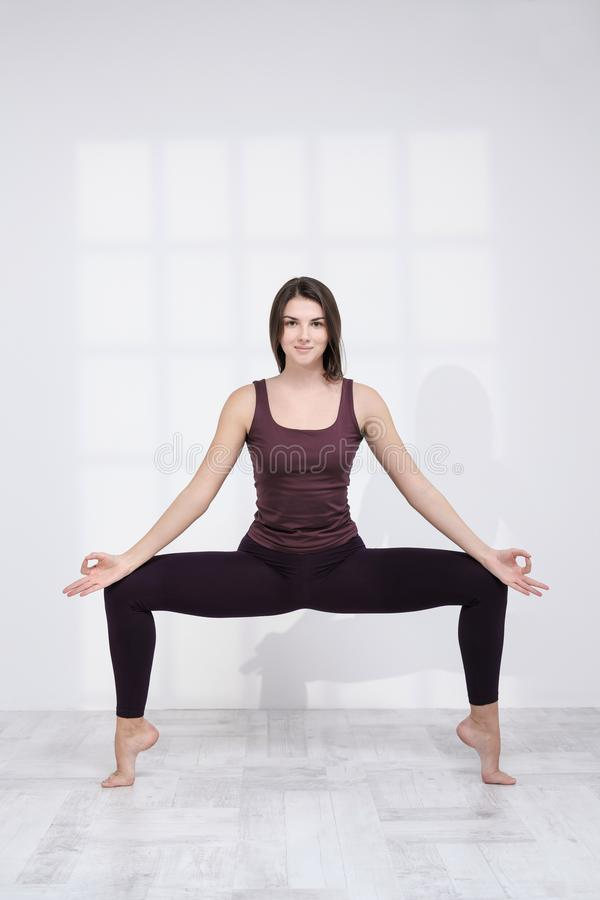 Sporty woman practicing yoga on white background royalty free stock photography