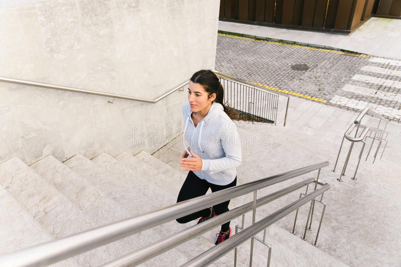 Download Sporty Woman Running And Climbing Stairs Stock Photo - Image: 71662748
