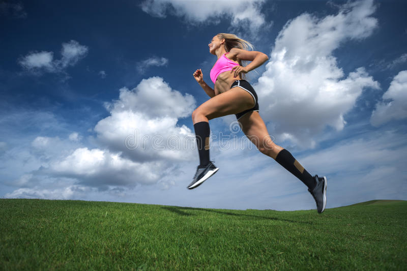 Sporty woman running. royalty free stock images