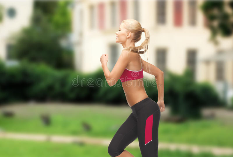 Download Sporty Woman Running Or Jumping Stock Photo - Image: 40264617