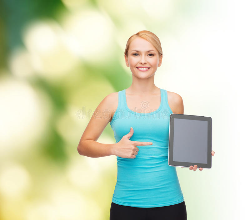 Sporty woman with tablet pc blank screen. Sport, excercise, technology, internet and healthcare - sporty woman with tablet pc blank screen stock photography