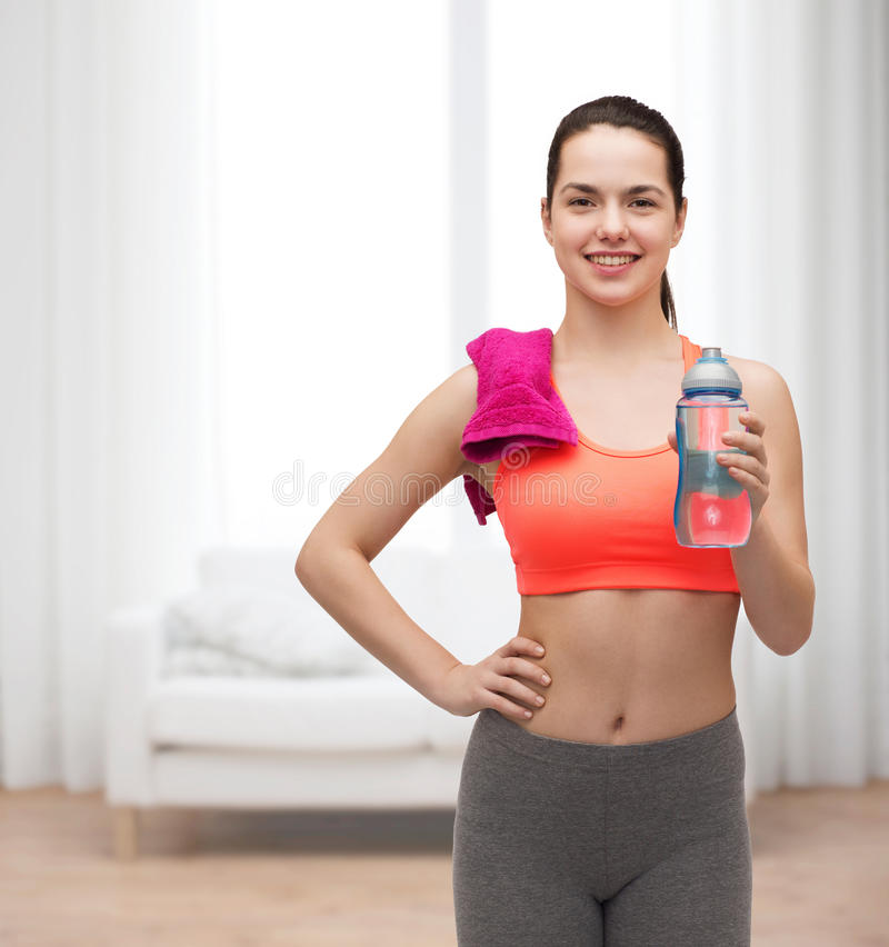 Download Sporty Woman With Towel And Water Bottle Stock Photo - Image: 40266018