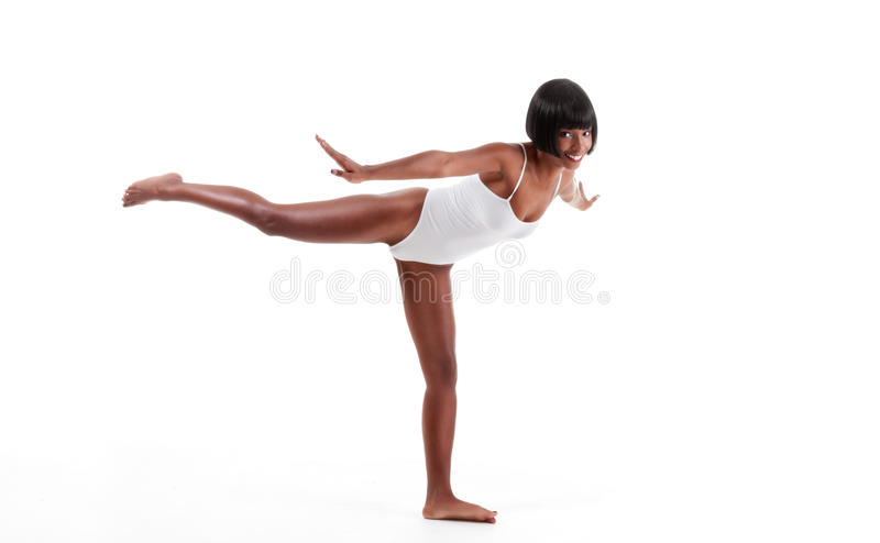 Sporty woman in white one piece swimsuit leotard royalty free stock images