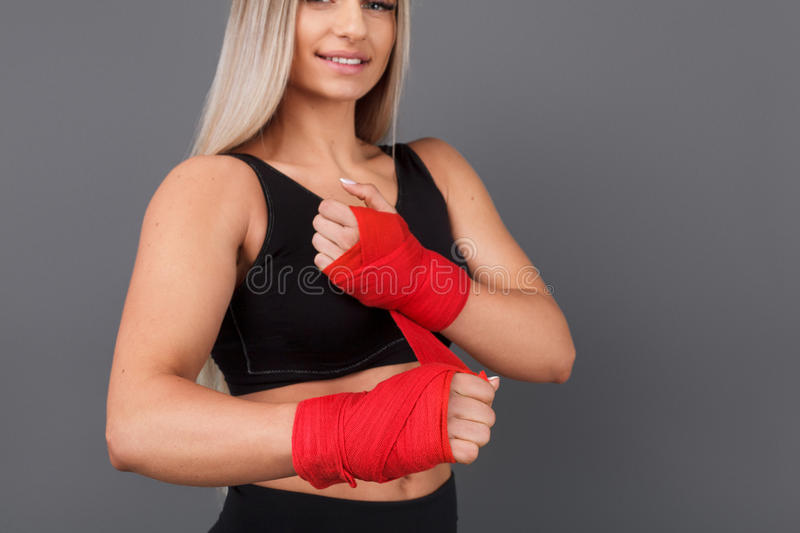 Sporty woman wrapping red bandage royalty free stock photos