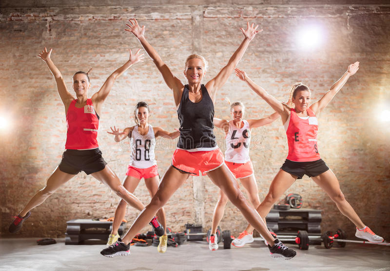 Sporty women doing jumping exercise stock photo