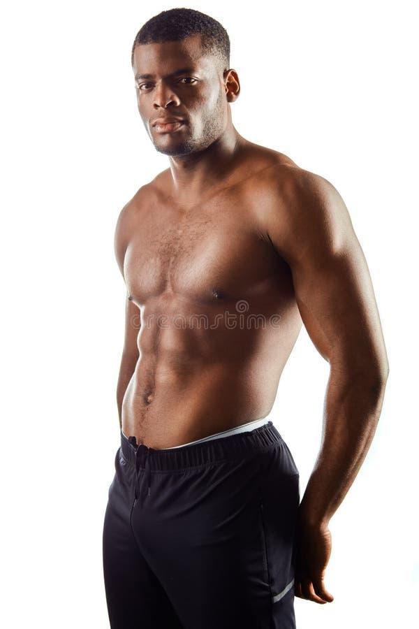 Sporty wspaniały poważny mężczyzna z mięśniowym ciałem fotografia royalty free