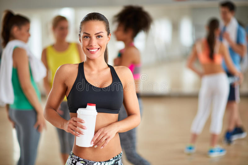 Sporty young brunette after training in gym royalty free stock photos