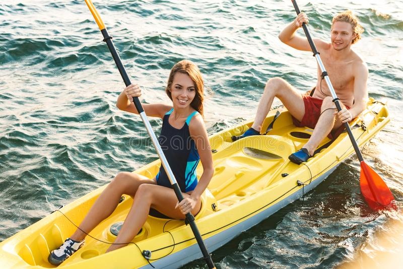 Sporty young couple kaying together stock photography
