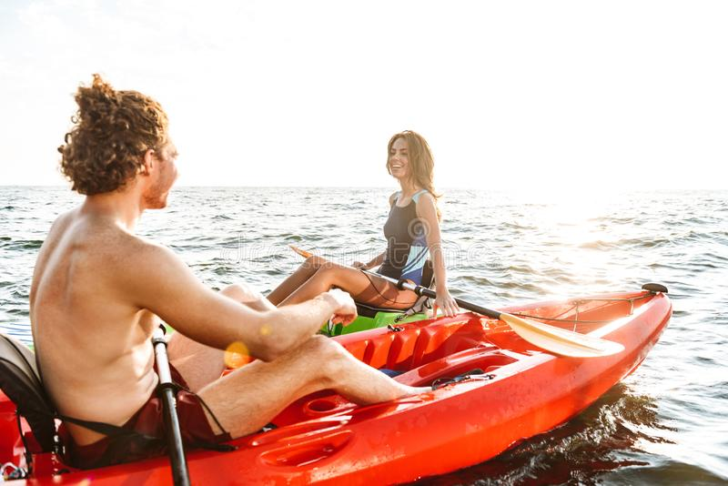 Sporty young couple kaying together royalty free stock image
