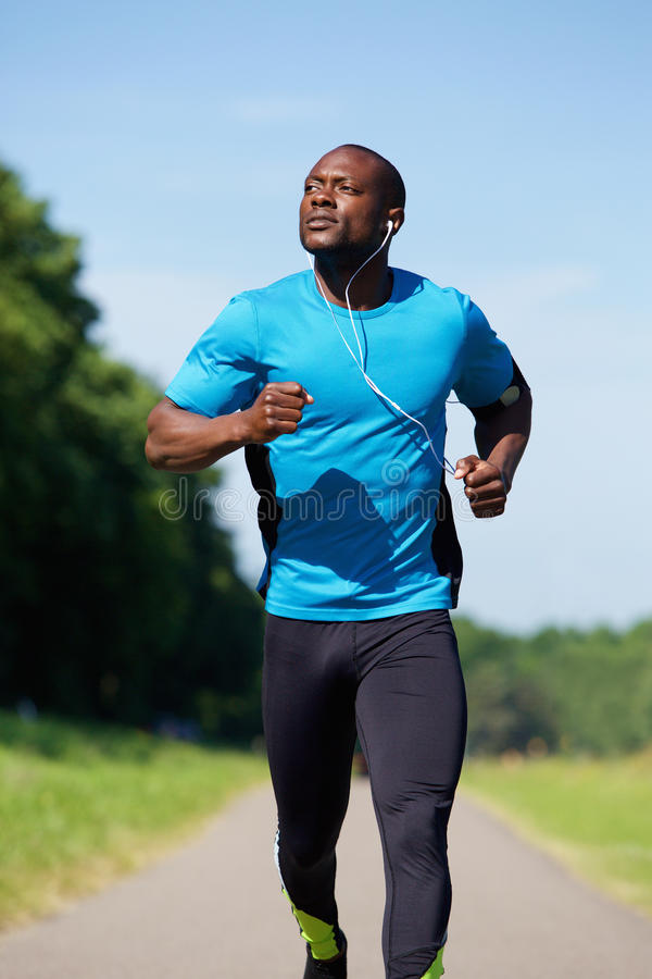Sporty young man running stock images