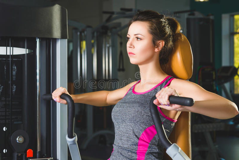 Sporty young woman doing exercise at the gym.  stock photo