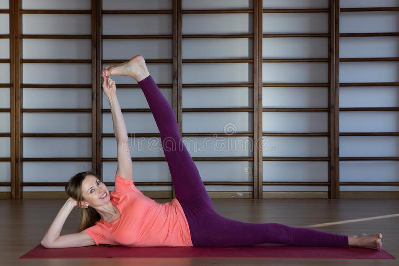 Sporty young woman doing yoga practice - concept of healthy life and natural balance between body and mental development. Relaxation and meditation stock photos