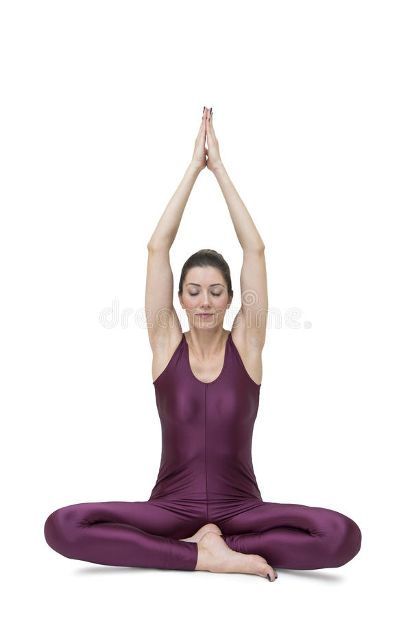 Sporty young woman doing yoga practice isolated on white background royalty free stock photos
