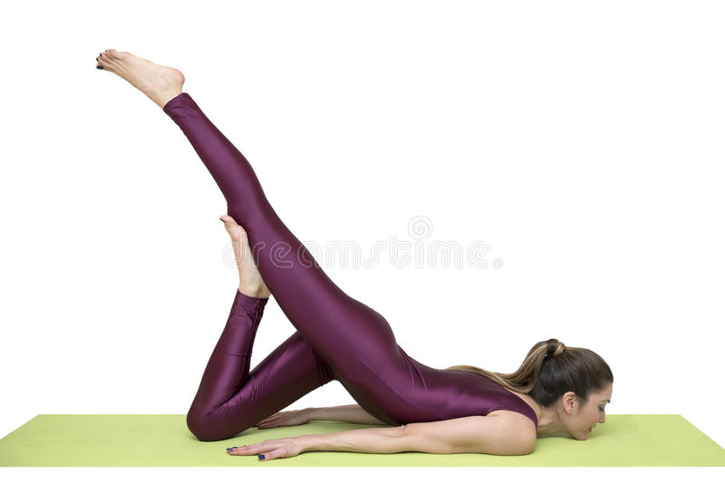 Sporty young woman doing yoga practice isolated on white background stock image