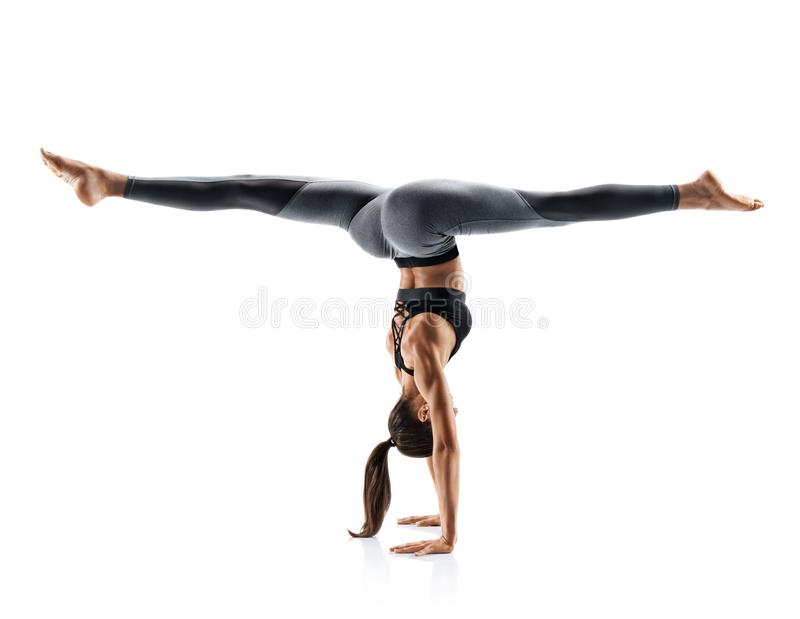 Sporty young woman doing yoga practice isolated on white background. royalty free stock photos