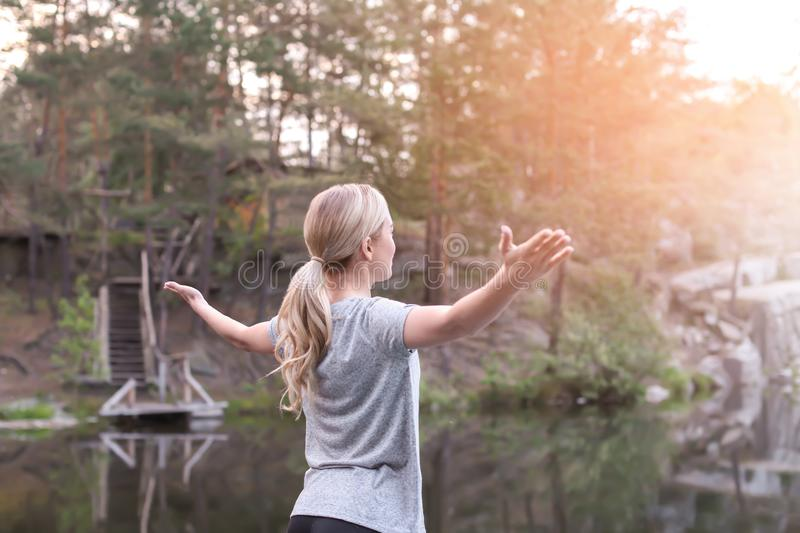 Sporty young woman enjoying nature in the morning stock images