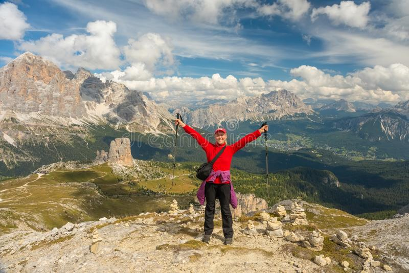 Sporty Young woman on mountain trail Dolomites Mountains, Italy royalty free stock images