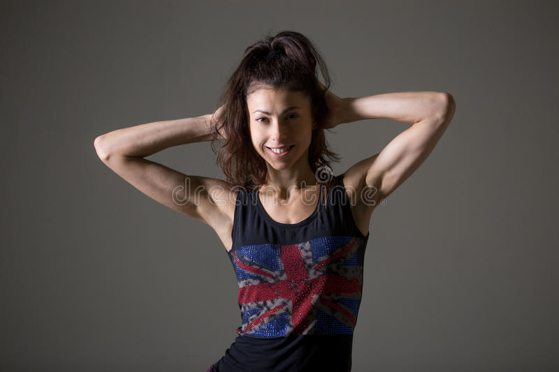 Sporty young woman portrait. Stylish sporty young woman lifestyle portrait. Fit girl wearing English flag tank top looking at camera. Happy caucasian female stock image